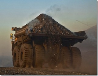 mining trucks and boom in australia